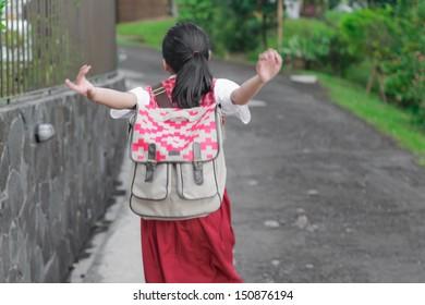 asian schoolgirl wearing backpack