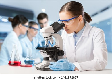 Asian scientist team has researching in laboratory.          - Image