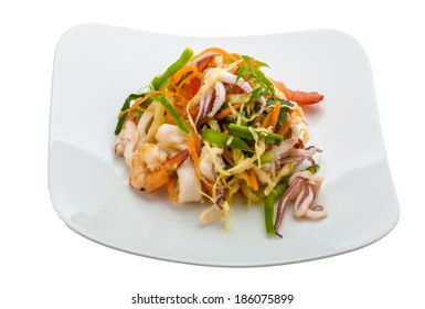 Asian seafood salad isolated on white