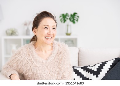 Asian senior age woman relaxing