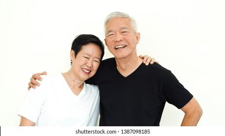 Asian senior couple happy together expression on white background