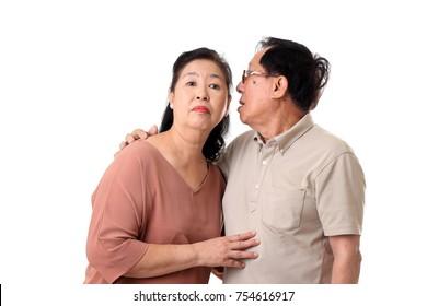 The Asian senior couple on the white background.