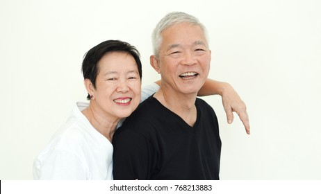 Asian senior couple smile together life with no worry on white background