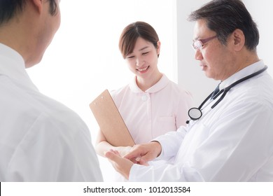 asian senior doctor