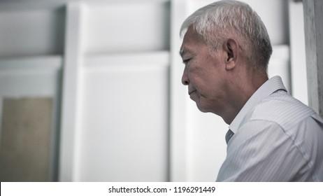 Asian senior elderly man worry about health medication at hospital