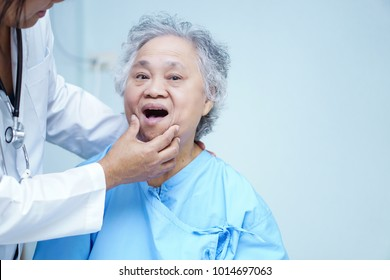 Asian senior or elderly old lady woman patient visiting dental doctor at nursing hospital