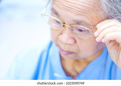 Asian senior or elderly old lady woman patient with grasses while sitting on bed in nursing hospital : healthy strong medical concept