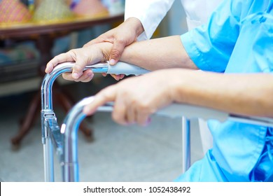Asian senior or elderly old lady woman patient with walker at nursing hospital : healthy strong medical concept