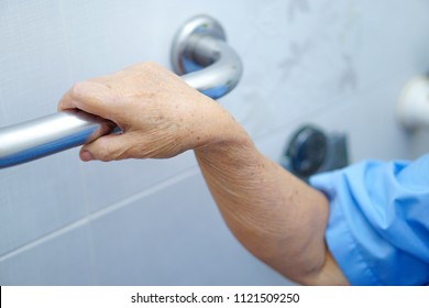 Asian senior or elderly old lady woman patient use toilet handle security in nursing hospital ward : healthy strong medical concept