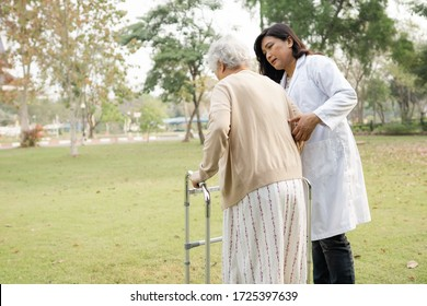 Asian senior or elderly old lady woman patient walk with walker in park : healthy strong medical concept