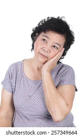 Asian senior female having a toothache holding his face with her hand, isolated on the white background.