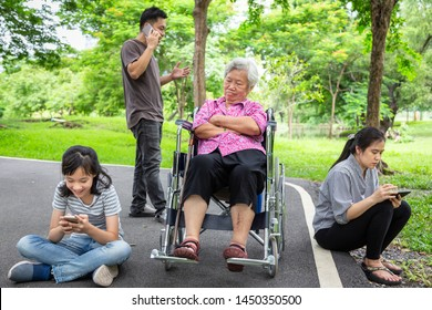 Asian senior grandmother lonely feeling abandoned;disappointed in family,elderly ignore bored;sad;frustrated,disregard,parents, child girl with mobile phone addict,daughter play game,social problem