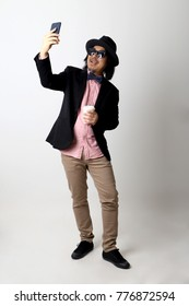 The Asian senior man in the casual clothes on the white background.