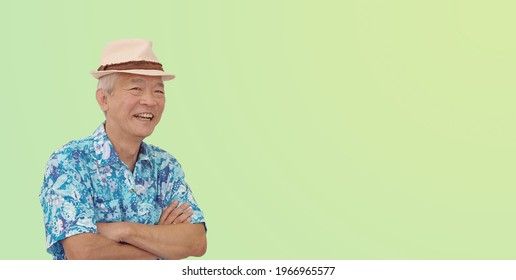 Asian senior man retired elderly in hawaii shirt straw hat happy vacation mode isolated copy space