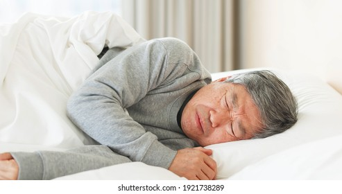 asian senior man suffered from insomnia in bedroom at home