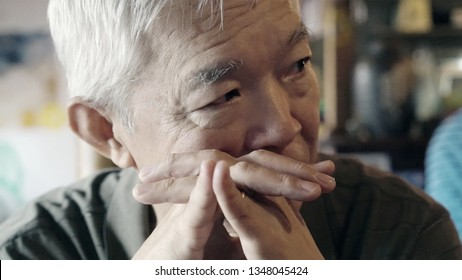 Asian senior man thinking about life vintage color