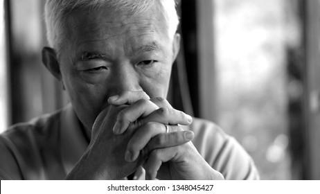Asian senior man worry stress thinking about life