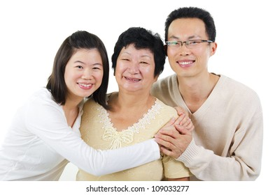 Asian senior mother and adult offsprings over white background