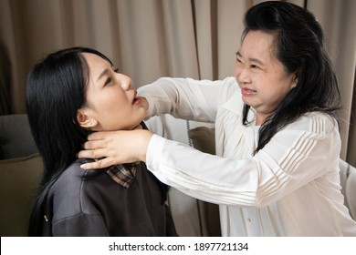 asian senior mother and young daughter with domestic violence and abusive physical assault problem in home