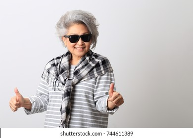 The Asian senior on the white background.