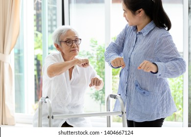 Asian senior people sitting relax with walker during rehabilitation and young carer,elderly woman or mother smiling and exercise with trainer or daughter at home,concept health care