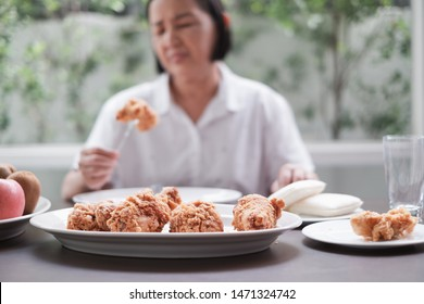 Asian Senior woman bored with food because indigestion