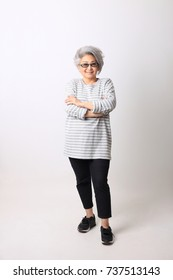 The Asian senior woman in casual clothes on the white background.