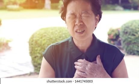 Asian senior woman chest pain heart attack stroke