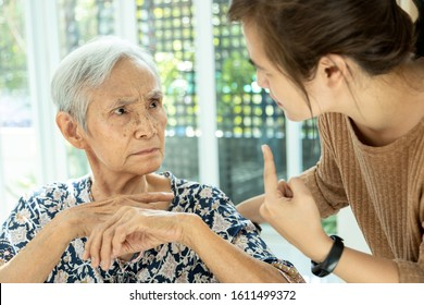 Asian senior woman is confused because she can not remember the face of their family or forget her daughter,memory loss in elderly people,female patients with cognitive impairment,alzheimer,dementia
