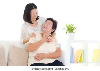 Asian senior woman and daughter
