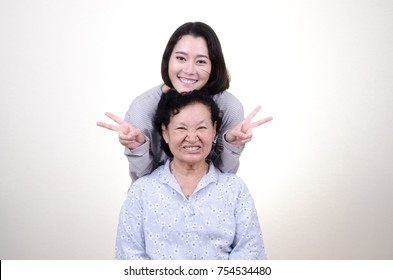 Asian Senior woman with daughter