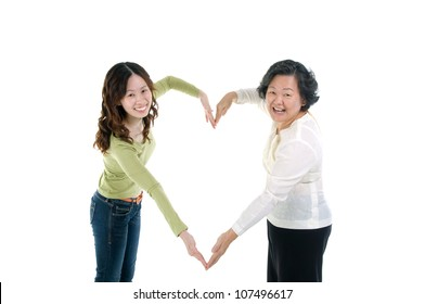 asian senior woman and daughter making the sign of love, isolated on white background