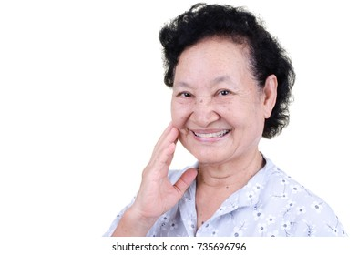 Asian Senior woman with glad expression over white background