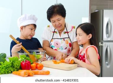 Asian senior woman and grandchildren prepared food in the kitchen