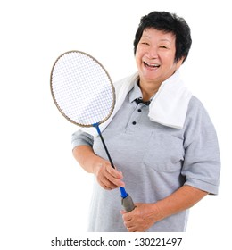 Asian senior woman healthy lifestyle. Happy Asian grandparent holding badminton racket isolated on white.