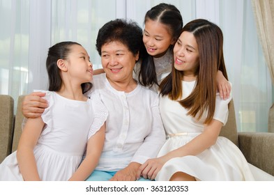 Asian senior woman and her daughter and granddaughters