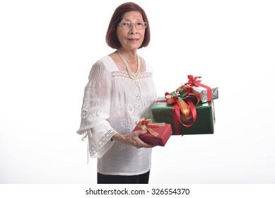 asian senior woman holding gift box