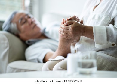 Asian Senior woman holding hands her husband. Healthcare Disease, illness, Comforting.
