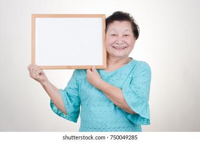 Asian senior woman holding signboard