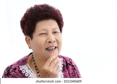 Asian senior woman make up her face on white background.