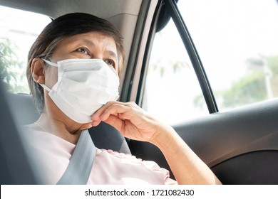 Asian Senior woman Passenger wear surgical mask for prevent and protection coronavirus or Covid-19 while sitting in car. Public transportation. Sanitation, Healthy, Pandemic Virus.