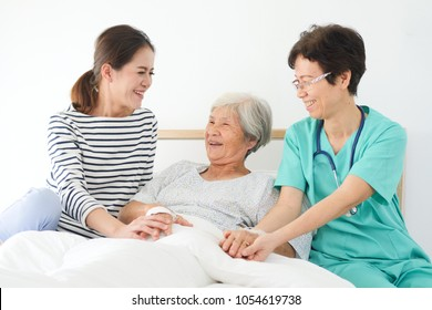 Asian senior woman sick in hospital with daughter and doctor take care in happy and smile mood