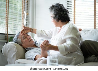 Asian Senior Woman is taking care her husband at their house. Healthcare, Illness.