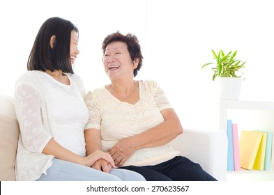 Asian senior woman talking with her daughter