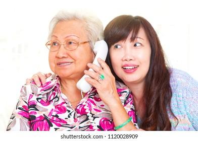 Asian senior woman talking on the phone