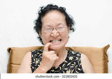 asian senior woman with toothache