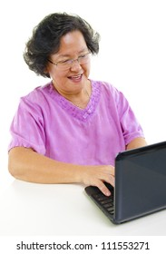 Asian senior woman using notebook over white background
