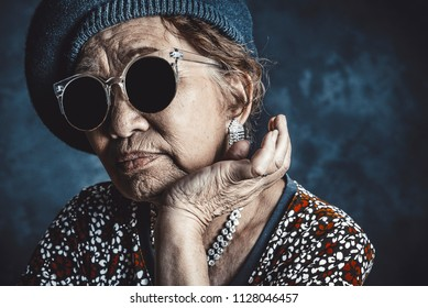 Asian senior woman wearing black sunglasses