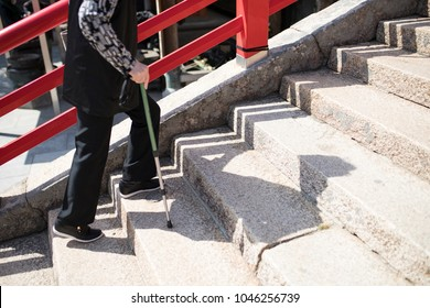 Asian seniors and stairs