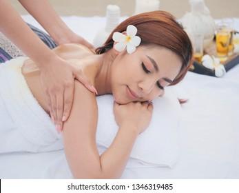 Asian sexy woman make spa massage on the beach